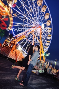 Kissing in front of Ferris Wheel
